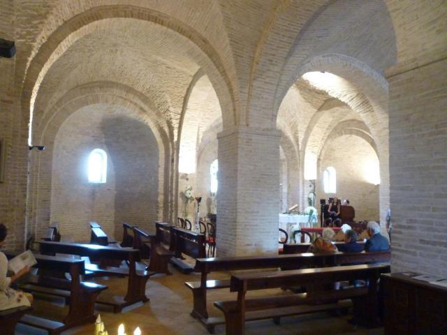 Interior of San Claudio al Chienti; the wedding singer is practising.